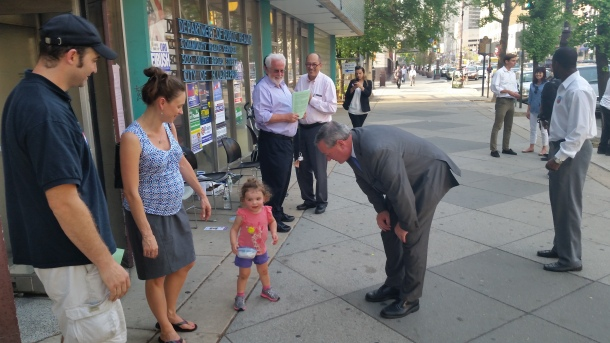 Late in the afternoon of the May 19 primary, Jim Kenney works to secure the next generation of voters. (Photo Credit: Matt Cassidy)